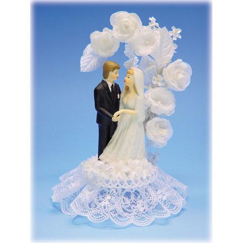 Bruidspaar Porselein C - op voetje met bloemenboog